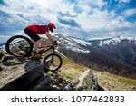 a man is riding enduro bicycle  ... | Shutterstock . vector #1077462833