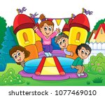 kids on inflatable castle theme ... | Shutterstock .eps vector #1077469010