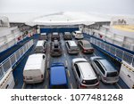 Small photo of ESTONIA- CIRCA MAR, 2018: Ferry-boat deck with passenger cars. Route from Virtsu mainland to Kuivastu, Muhu island in icy strait. TS Laevad is an Estonian company operates two routes in Baltic Sea