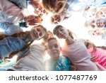 friendship of schoolchildren  | Shutterstock . vector #1077487769
