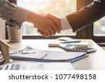 top view hands of agent and... | Shutterstock . vector #1077498158