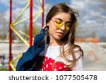 young sportive hipster woman...   Shutterstock . vector #1077505478