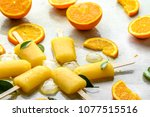 orange popsicles with frozen... | Shutterstock . vector #1077515516