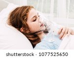 cute little girl oxygen mask on ... | Shutterstock . vector #1077525650