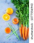 carrot and orange fresh juice... | Shutterstock . vector #1077556943