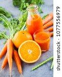 carrot and orange fresh juice... | Shutterstock . vector #1077556979