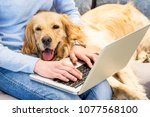 woman typing on laptop while... | Shutterstock . vector #1077568100