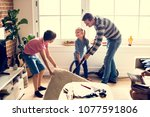 kids helping house chores | Shutterstock . vector #1077591806
