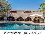 victoria falls  zimbabwe ...   Shutterstock . vector #1077604193