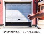 garage door pvc. hand use... | Shutterstock . vector #1077618038
