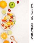fruity summer salad in white...   Shutterstock . vector #1077633596