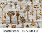 vintage antique keys on a light ... | Shutterstock . vector #1077636119