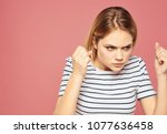 strict woman on a pink...   Shutterstock . vector #1077636458