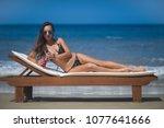 young girl sunbathing on the...   Shutterstock . vector #1077641666