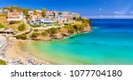 sandy varkotopos beach in sea... | Shutterstock . vector #1077704180