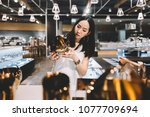 woman shopping for kitchenware... | Shutterstock . vector #1077709694