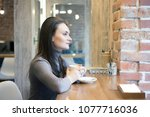 beautiful young businesswoman... | Shutterstock . vector #1077716036