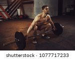 fit man lifting heavy weights.... | Shutterstock . vector #1077717233