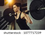fit woman lifting heavy weights.... | Shutterstock . vector #1077717239
