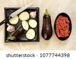 sliced and whole eggplant... | Shutterstock . vector #1077744398