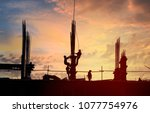 silhouette of workers at... | Shutterstock . vector #1077754976