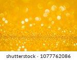abstract golden glitter bokeh... | Shutterstock . vector #1077762086