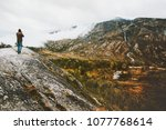 man traveler standing alone on... | Shutterstock . vector #1077768614