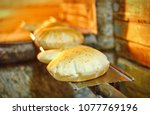 pita bread in oven | Shutterstock . vector #1077769196