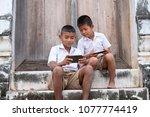 two asian boys wearing school... | Shutterstock . vector #1077774419