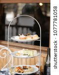 Small photo of High tea or afternoon tea. Patisseries and bakeries such as scones and sandwiches are on the cake stand ready to be served on the cruise.