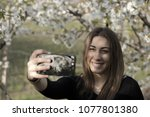 authentic girl with a black t...   Shutterstock . vector #1077801380