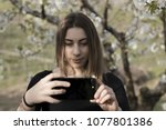 authentic girl taking photos...   Shutterstock . vector #1077801386