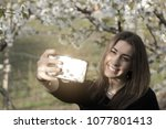 authentic girl with a black t...   Shutterstock . vector #1077801413