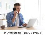 young man talking on mobile... | Shutterstock . vector #1077819836
