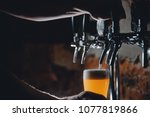light draft cold beer pour in... | Shutterstock . vector #1077819866