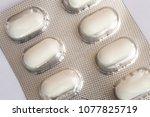 blister of medication pills | Shutterstock . vector #1077825719