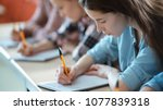 shot of the row of students... | Shutterstock . vector #1077839318