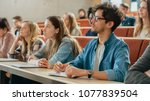 in the classroom multi ethnic... | Shutterstock . vector #1077839504