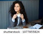 female working on laptop in... | Shutterstock . vector #1077855824