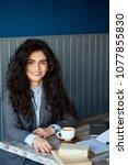 female working on laptop in... | Shutterstock . vector #1077855830