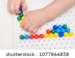 the child plays with a mosaic... | Shutterstock . vector #1077866858