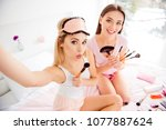Small photo of Self portrait of pretty, charming, attractive, cute, stylish, successful, cheerful, girls in white and pink outfit having different brushes in hands shooting selfie on front camera with pout lips