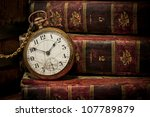 old clock over books still life ...