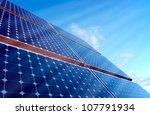 Sun is shining onto a solar panel - stock photo