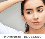 confused hispanic teenager | Shutterstock . vector #1077932390