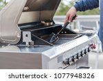 cleaning outdoor gas grill... | Shutterstock . vector #1077948326