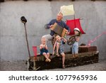 three cute boys with father as... | Shutterstock . vector #1077965936