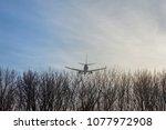 big passenger airplane flying... | Shutterstock . vector #1077972908
