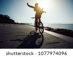 hands free cycling cyclist... | Shutterstock . vector #1077974096