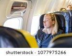 tired blonde casual caucasian... | Shutterstock . vector #1077975266